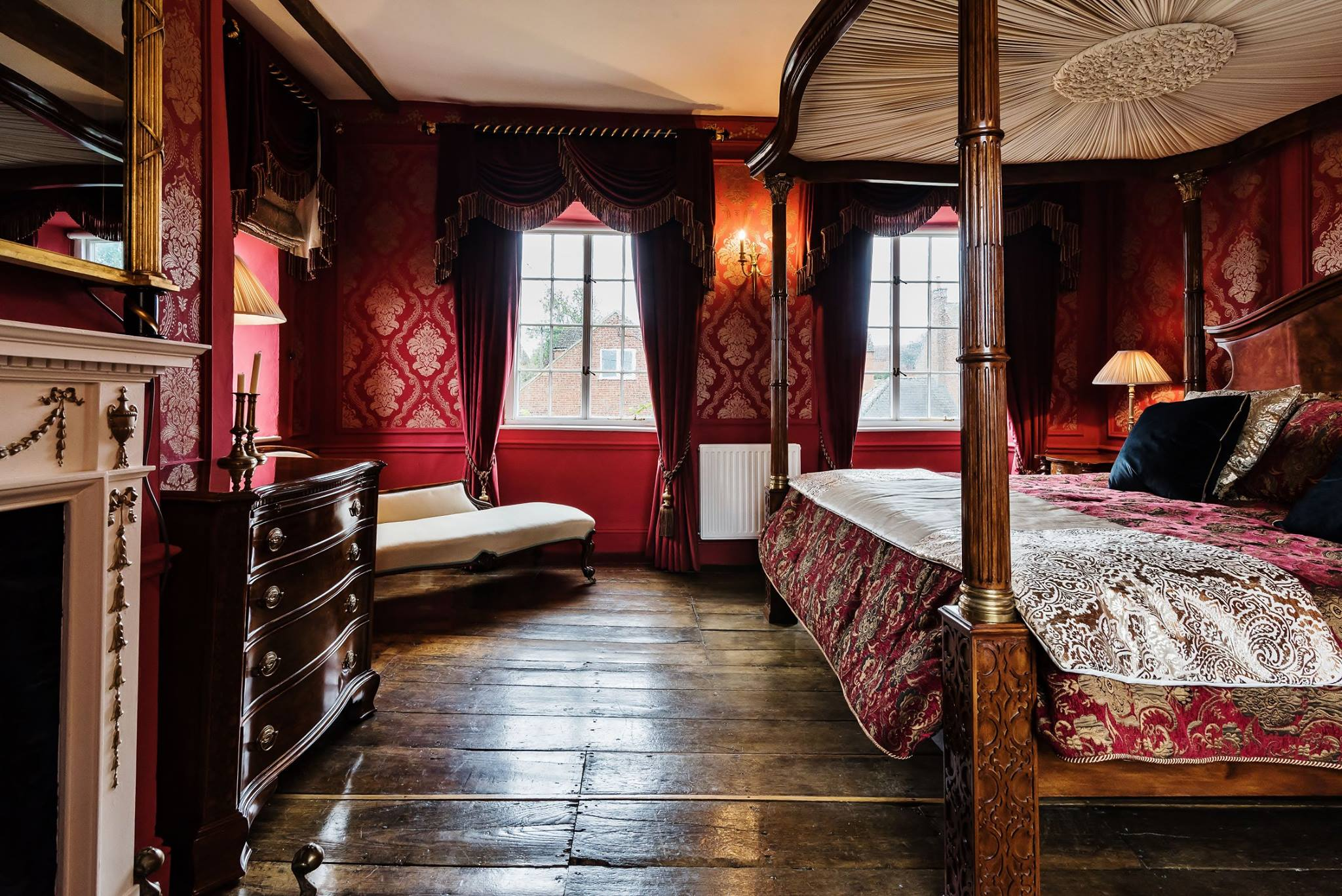 The Red Bedroom with Open Twist Curtain Poles and Acanthus & Flambeau Finials by Edward Harpley